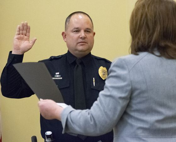 Commander Robert Holt taking the Oath of Office.