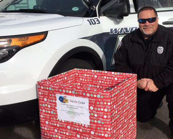 Officer Hogsett with a Santa Cops donation box